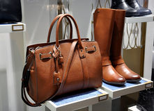 Women brown boots and leather bag. In store window Stock Image