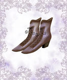 Women brown halfboots-on lacing  on light grunge background Royalty Free Stock Photography