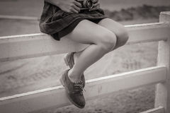 Women with brown shoe on the white fence. The women with brown shoe on the white fence Stock Images