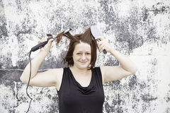 Women brush and irons Stock Photography