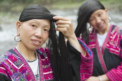 Women brush and style hair in Longji, China. Stock Images