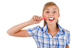 Women brushing her teeth Royalty Free Stock Photo
