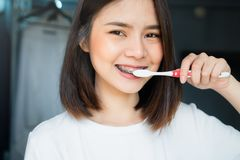 Women are brushing teeth that wear braces, in a toilet. Must maintain good oral health. Women are brushing teeth that wear braces, in a toilet. Must maintain stock photography
