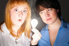 Women with bulb Royalty Free Stock Image