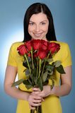 Women with bunch of roses. Beautiful middle-aged women holding a Stock Images