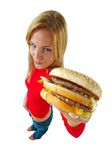 Women and burger. Young woman with burger on hand Royalty Free Stock Images