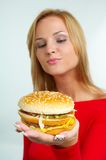 Women and burger Royalty Free Stock Images