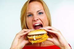 Women and burger. Young woman with burger on hand Stock Photo