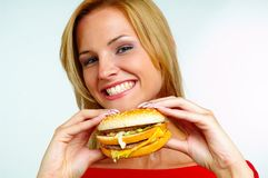 Women and burger. Young woman with burger on hand Royalty Free Stock Photos
