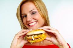 Women and burger royalty free stock photos