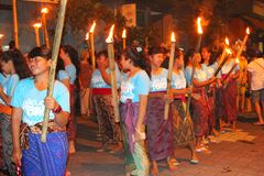 Women with burning torches at a procession,Bali, Indonesia  Stock Photos