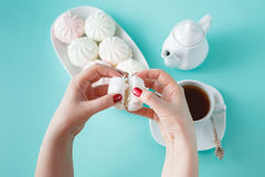 Women burst colored marshmallow for breakfast Royalty Free Stock Photos