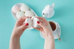 Women burst colored marshmallow for breakfast Royalty Free Stock Image
