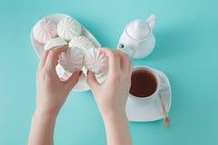Women burst colored marshmallow for breakfast Stock Images