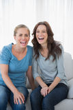 Women bursting out laughing Stock Photography