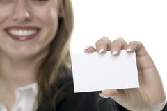 Women with business card in hand. And white background Royalty Free Stock Photography
