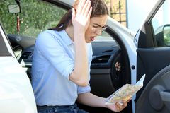 Angry lost women in the car. Women business map problem lost beautiful young driver problem attractive Royalty Free Stock Photo
