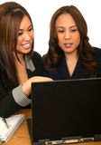 Women Business Team Pointing At Laptop Stock Photos