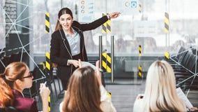 Women business training female coach speaker. Women business training presentation. Female coaching. Business ladies listening to a speaker stock photo