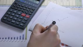 Women businesswoman using calculator. Secretary hands working with calculator. Close-up of businesswoman using calculator. Secretary hands working with stock video footage