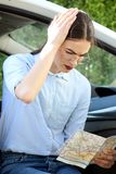 Lost young women. Women busness map problem lost beautiful young driver problem attractive Stock Photo