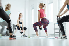 Women during workout. On a gym royalty free stock photos