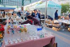 Women buy second-hand crockery on the popular market