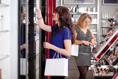 Women buying cosmetics Royalty Free Stock Photography