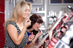 Women buying cosmetics Royalty Free Stock Photo