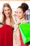 Women buying fashion clothes in shop or store Royalty Free Stock Photo