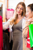 Women buying fashion in shop or store Stock Photography
