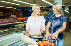 Women buying frozen vegetables Stock Image