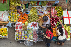 Women buying fruits from a stall in Hong Kong Stock Photos
