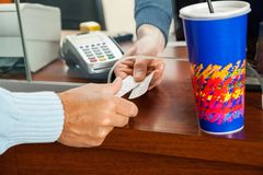 Women Buying Movie Tickets At Box Office Stock Photography