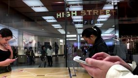 Women buying new iphone stock footage