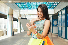 Women buying online through a digital tablet Stock Photography
