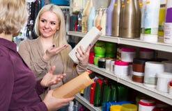 Women buying shampoo Royalty Free Stock Photo
