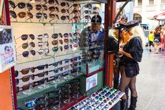 Women buying sunglasses Stock Images