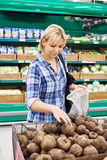 Women buys beets in store Royalty Free Stock Photography