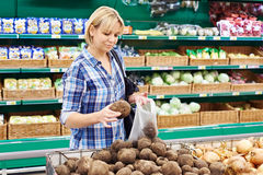 Women buys beets in store Stock Photos