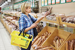 Women bying bread Royalty Free Stock Photos