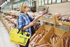 Women bying bread. Women shopping bread in supermarket Royalty Free Stock Photos