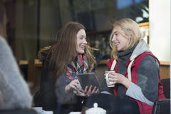 Women in a cafe with a digital tablet Royalty Free Stock Photography