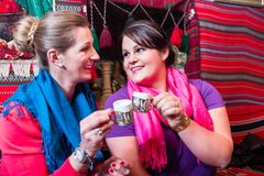 Women in cafe drinking espresso coffee Royalty Free Stock Photography
