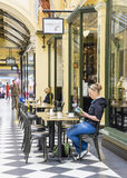 Women in cafe in Melbourne. Melbourne, Australia - September 5, 2015:  View of women reading and drinking in a cafe in The Block Arcade, a heritage shopping mall Royalty Free Stock Photos