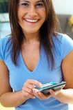 Women with calculator Royalty Free Stock Image