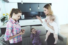 The woman came home and chastises the nurse, who did not follow the children well. The women came home and chastises the nurse, who did not follow the children Royalty Free Stock Photo