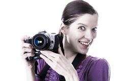 Very excited emotion of woman with camera Royalty Free Stock Image