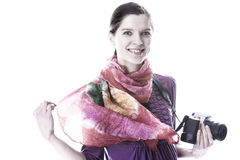 Happy smiling woman holding a camera Stock Photography