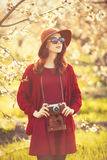 Women with camera in blossom apple tree garden Royalty Free Stock Photos